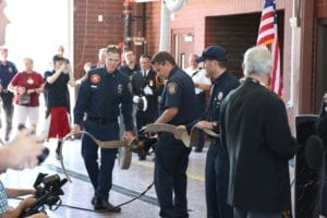Firefighter Ribbon Cutting with Firehose